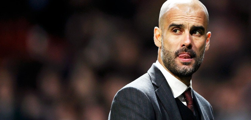 Bayern Munich's coach Guardiola reacts after their Champions League quarter-final first leg soccer match against Manchester United at Old Trafford in Manchester