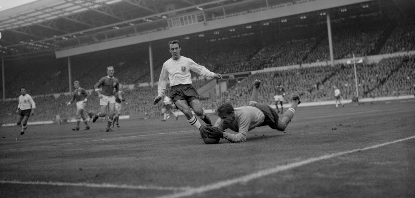 23rd October 1963:  Rest of the World goalie Lev Yashin saves the ball from the feet of England inside right Jimmy Greaves during a Football Association match at Wembley.  (Photo by Dennis Oulds/Central Press/Getty Images)