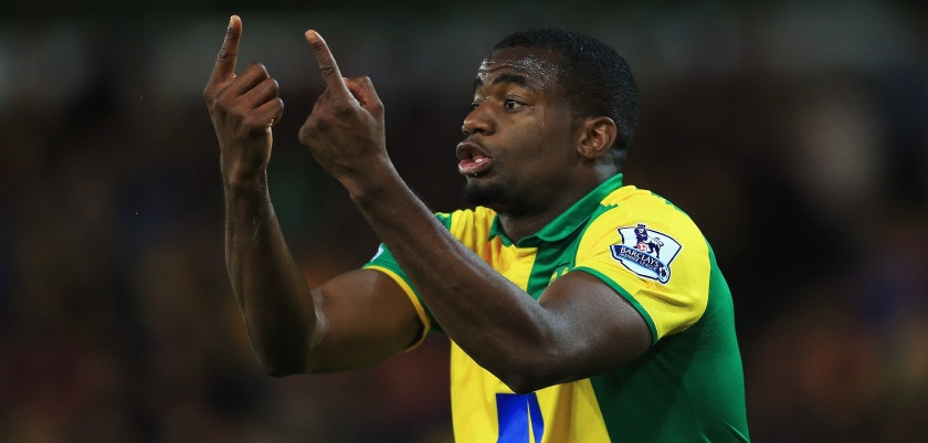 NORWICH, ENGLAND - NOVEMBER 29:  Sebastien Bassong of Norwich City reacts during the Barclays Premier League match between Norwich City and Arsenal at Carrow Road on November 29, 2015 in Norwich, England.  (Photo by Stephen Pond/Getty Images)