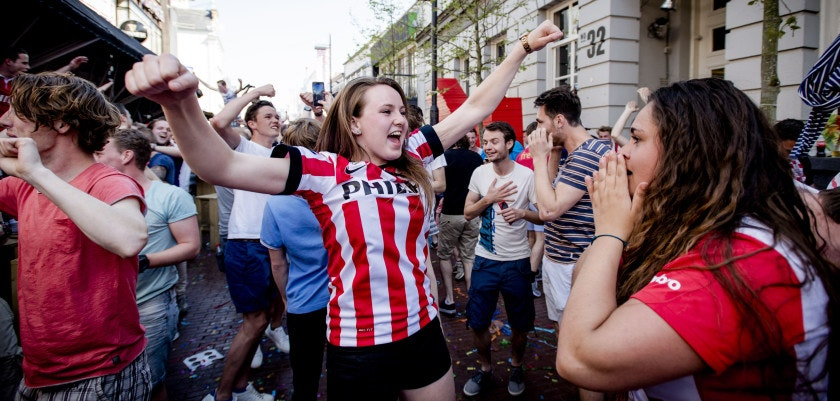 Fans of PSV Eindhoven celebrate in the street after their team won the Dutch league title in Eindhoven on May 8, 2016.  PSV Eindhoven clinched their 23rd Dutch league title with a 3-1 defeat of PEC Zwolle after title rivals Ajax were held 1-1 at De Graafschap.  / AFP / ANP / Robin van Lonkhuijsen / Netherlands OUT        (Photo credit should read ROBIN VAN LONKHUIJSEN/AFP/Getty Images)