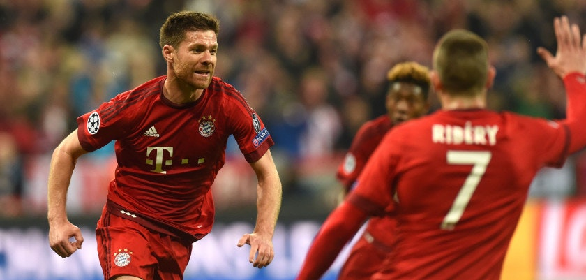 Bayern Munich's Spanish midfielder Xabi Alonso (L) runs to celebrate scoring with Bayern Munich's French midfielder Franck Ribery (R) during the UEFA Champions League semi-final, second-leg football match between FC Bayern Munich and Atletico Madrid in Munich, southern Germany, on May 3, 2016. / AFP / Christof Stache        (Photo credit should read CHRISTOF STACHE/AFP/Getty Images)