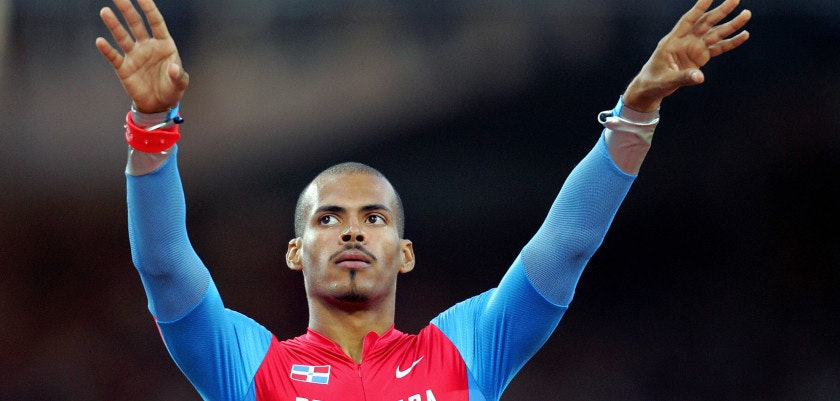ATHENS, Greece:  Felix Sanchez of the Dominican Republic gestures after he won heat four, round one of the men's 400m hurdles, 23 August 2004, during the Olympic Games athletics competitions at the Olympic Stadium in Athens. AFP PHOTO/FRANCK FIFE  (Photo credit should read FRANCK FIFE/AFP/Getty Images)