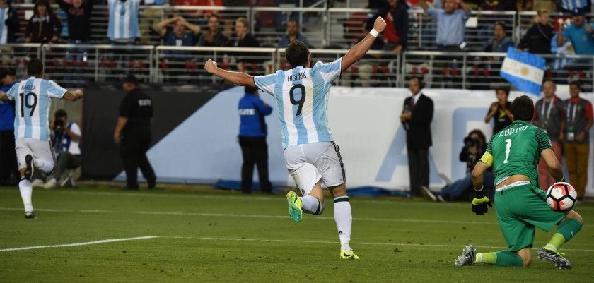 Argentina's Gonzalo Higuain (C) celebrates after teammate Ever Banega (L) scored against Chile during their Copa America Centenario football tournament match in Santa Clara, California, United States, on June 6, 2016.  / AFP / Mark Ralston        (Photo credit should read MARK RALSTON/AFP/Getty Images)