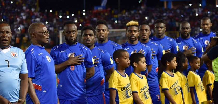 Haitian President Jocelerme Privert (2nd L) stands with Haitians players on the field before the beginning of the Russia 2018 FIFA World Cup Concacaf Qualifiers football match against Panama, in the Stadium Sylvio Cator, in Port-au-Prince, on March 25, 2016 / AFP / HECTOR RETAMAL        (Photo credit should read HECTOR RETAMAL/AFP/Getty Images)