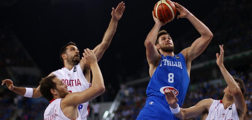 Italy's power forward Danilo Gallinari  tries to score past Croatia's forward Dario Saric (R ) during the final match of the Olympic Qualifying Tournament Croatia vs Italy at PalaIsozaki in Turin on July 9, 2016. / AFP / MARCO BERTORELLO        (Photo credit should read MARCO BERTORELLO/AFP/Getty Images)