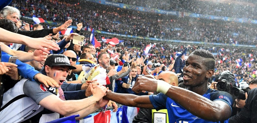 TOPSHOT - France fans react as midfielder Paul Pogba comes over to greet them after France beat Iceland 5-2 in the Euro 2016 quarter-final football match between France and Iceland at the Stade de France in Saint-Denis, near Paris, on July 3, 2016.  / AFP / FRANCK FIFE        (Photo credit should read FRANCK FIFE/AFP/Getty Images)