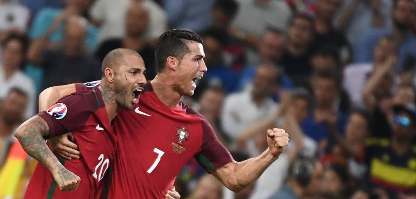 Portugal's forward Ricardo Quaresma (L) and Portugal's forward Cristiano Ronaldo celebrate after winning  the Euro 2016 quarter-final football match between Poland and Portugal at the Stade Velodrome in Marseille on June 30, 2016. / AFP / ANNE-CHRISTINE POUJOULAT        (Photo credit should read ANNE-CHRISTINE POUJOULAT/AFP/Getty Images)