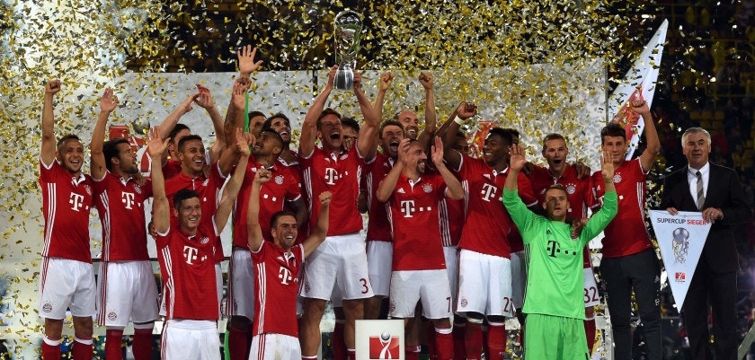 The players of FC Bayern Munich celebrate with the trophy after their 2-0 win during the German Super Cup football match final Borussia Dortmund vs FC Bayern Munich in Dortmund on August 14, 2016. / AFP / PATRIK STOLLARZ / RESTRICTIONS: DURING MATCH TIME: DFL RULES TO LIMIT THE ONLINE USAGE TO 15 PICTURES PER MATCH AND FORBID IMAGE SEQUENCES TO SIMULATE VIDEO. == RESTRICTED TO EDITORIAL USE == FOR FURTHER QUERIES PLEASE CONTACT DFL DIRECTLY AT + 49 69 650050         (Photo credit should read PATRIK STOLLARZ/AFP/Getty Images)