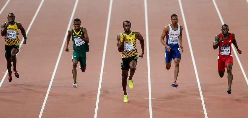 BEIJING, CHINA - AUGUST 27: Usain Bolt (C) of Jamaica crosses the finish line to win gold ahead of second place Justin Gatlin of the United States (R) and Anaso Jobodwana of South Africa (2nd L) in the Men's 200 metres final during day six of the 15th IAAF World Athletics Championships Beijing 2015 at Beijing National Stadium on August 27, 2015 in Beijing, China.  (Photo by Lintao Zhang/Getty Images for IAAF)