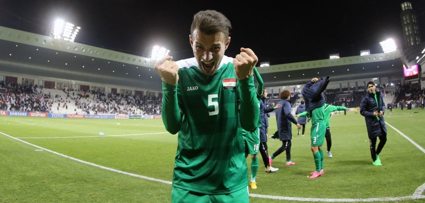 Iraq's defender Ali Faez celebrates after defeating Qatar during their AFC U23 Championship 3rd place football match between Qatar and Iraq in Doha on January 29, 2016. Iraq were crowned 3rd place winners in the competition after defeating Qatar 2-1 in extra time. / AFP / Karim JAAFAR        (Photo credit should read KARIM JAAFAR/AFP/Getty Images)