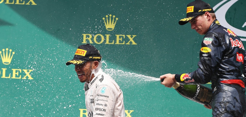 HOCKENHEIM, GERMANY - JULY 31: Lewis Hamilton of Great Britain and Mercedes GP and Max Verstappen of Netherlands and Red Bull Racing celebrate on the podium during the Formula One Grand Prix of Germany at Hockenheimring on July 31, 2016 in Hockenheim, Germany.  (Photo by Mark Thompson/Getty Images)