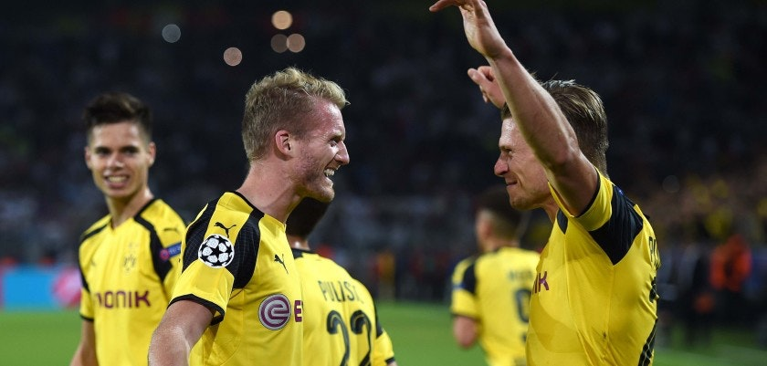 Dortmund's midfielder André Schuerrle (C) celebrates after scoring with Dortmund's Polish defender Lukasz Piszczek during the UEFA Champions League first leg football match between Borussia Dortmund and Real Madrid at BVB stadium in Dortmund, on September 27, 2016. / AFP / PATRIK STOLLARZ        (Photo credit should read PATRIK STOLLARZ/AFP/Getty Images)