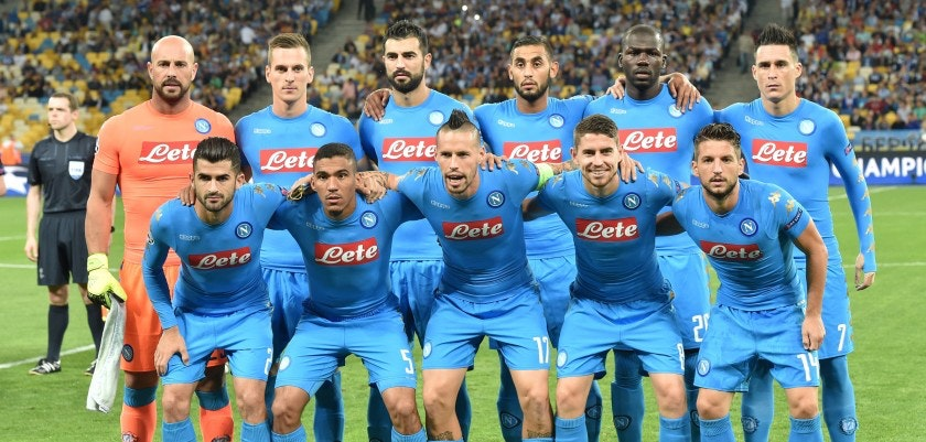 Naples players pose ahead of the Champions League football match between FC Dynamo and SSC Napoli at the Olympiyski Stadium in Kiev on September 13, 2016. (Front row L-R): midfielder Dries Mertens, midfielder Allan, midfielder Marek Hamsik , midfielder Jorginho , midfielder Dries Mertens; (Upper row L-R): goalkeeper Pepe Reina, forward Arkadiusz Milik, defender Elseid Hysaj,  defender Faouzi Ghoulam , defender Kalidou Koulibaly ,  forward Jose Callejon. / AFP / SERGEI SUPINSKY        (Photo credit should read SERGEI SUPINSKY/AFP/Getty Images)