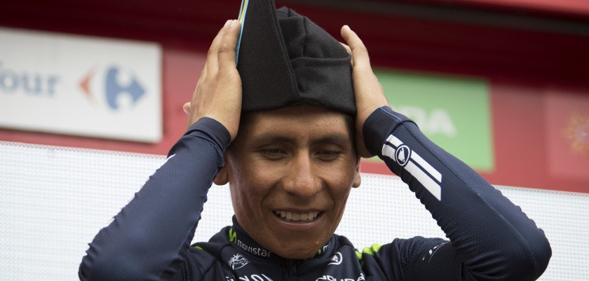 "Movistar's Colombian cyclist Nairo Quintana celebrates on the podium after winning the10th stage of the 71st edition of ""La Vuelta"" Tour of Spain, a 188,7km route between Lugones to Lagos de Covadonga on August 29, 2016. / AFP / JAIME REINA        (Photo credit should read JAIME REINA/AFP/Getty Images)"