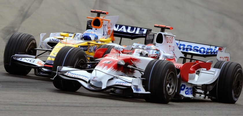 Renault's Spanish driver Fernando Alonso (L) tries to overtake Toyota's Italian driver Jarno Trulli at the Hockenheim ring racetrack on July 20, 2008 in Hockenheim, during the German Formula One Grand Prix.   AFP PHOTO / Bertrand Guay (Photo credit should read BERTRAND GUAY/AFP/Getty Images)