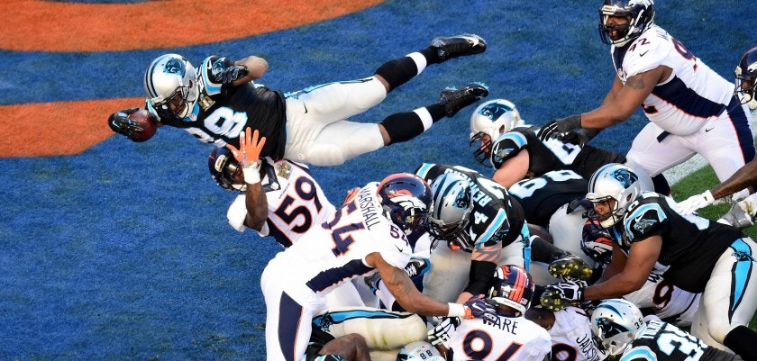 SANTA CLARA, CA - FEBRUARY 07:  Jonathan Stewart #28 of the Carolina Panthers dives for a 1-yard touchdown during the second quarter of Super Bowl 50 against the Denver Broncos at Levi's Stadium on February 7, 2016 in Santa Clara, California.  (Photo by Harry How/Getty Images)