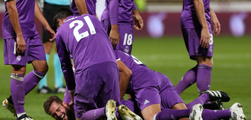 Real Madrid's defender Nacho Fernandez (Bottom) celebrates a goal with teammates during the Spanish Copa del Rey (King's Cup) round of 32 first leg football match between Cultural y Deportiva Leonesa and Real Madrid at the Reino de Leon stadium in Leon, on October 26, 2016. / AFP / CESAR MANSO        (Photo credit should read CESAR MANSO/AFP/Getty Images)