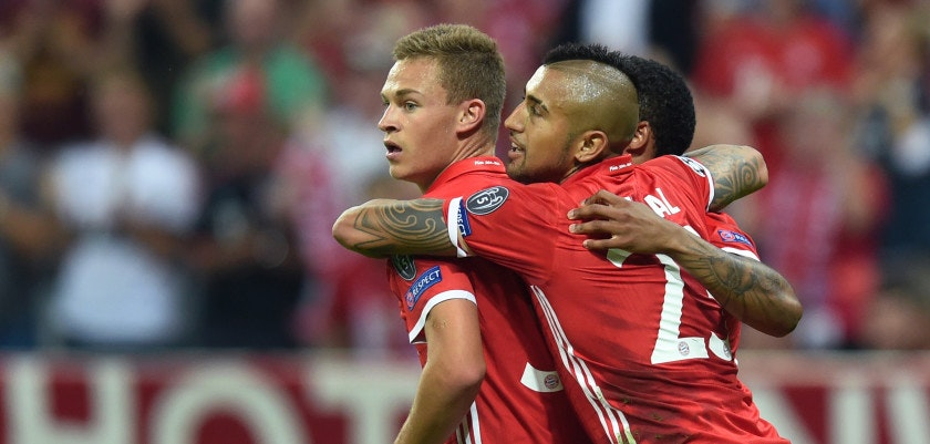 (L-R) Bayern Munich's midfielder Joshua Kimmich, Bayern Munich's Chilian midfielder Arturo Vidal and Bayern Munich's Brazilian midfielder Douglas Costa celebrate after the third goal during the Champions League group D football match between Bayern Munich and Rostov in Munich, southern Germany, on September 13, 2016.  / AFP / CHRISTOF STACHE        (Photo credit should read CHRISTOF STACHE/AFP/Getty Images)