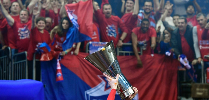 CSKA Moscow players show their trophy to supporters after winning the final at the Euroleague Final Four in Berlin on May 15, 2016. CSKA Moscow defeated Fenerbahce Istanbul 101 to 96, to take the trophy. / AFP / John MACDOUGALL        (Photo credit should read JOHN MACDOUGALL/AFP/Getty Images)