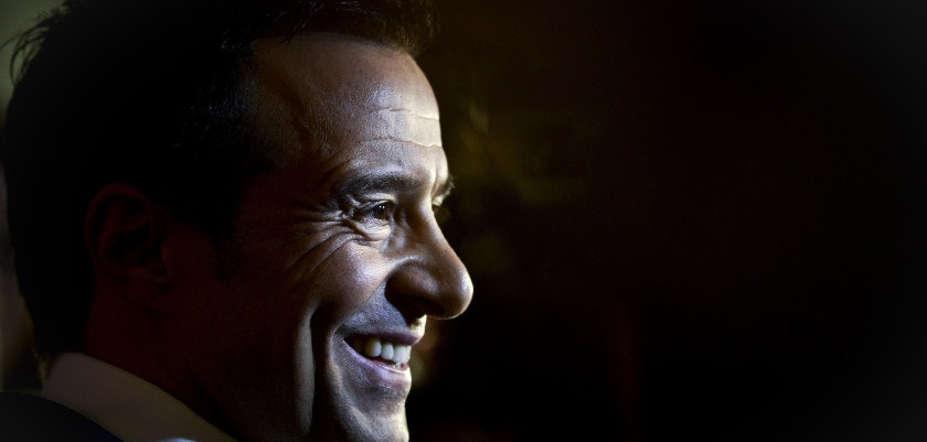 """Portuguese football manager Jorge Mendes stands in front of the press during the release of the book """"The Special Agent"""" written by Miguel Cuesta and Jonathan Sanchez in Lisbon on February 2, 2015. AFP PHOTO/ PATRICIA DE MELO MOREIRA        (Photo credit should read PATRICIA DE MELO MOREIRA/AFP/Getty Images)"""
