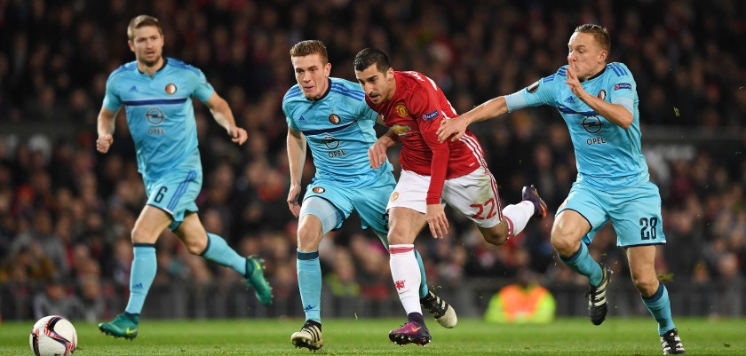 MANCHESTER, ENGLAND - NOVEMBER 24:  Henrikh Mkhitaryan of Manchester United goes between Jens Toornstra (28) and Wessel Dammers of Feyenoord (31) during the UEFA Europa League Group A match between Manchester United FC and Feyenoord at Old Trafford on November 24, 2016 in Manchester, England.  (Photo by Gareth Copley/Getty Images)