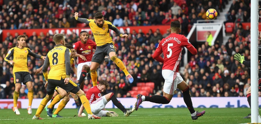 MANCHESTER, ENGLAND - NOVEMBER 19:  Olivier Giroud of Arsenal (C) scores his sides first goal during the Premier League match between Manchester United and Arsenal at Old Trafford on November 19, 2016 in Manchester, England.  (Photo by Michael Regan/Getty Images)