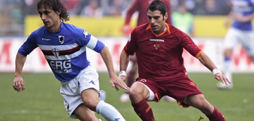GENOA, ITLAY - NOVEMBER 26:  Simone Perrotta  (R) of Roma and Sergio Volpi of Sampdoria in action during the Serie A match between Sampdoria and Roma at Marassi stadium on November 26, 2006 in Genoa, Italy.  (Photo by New Press/Getty Images)