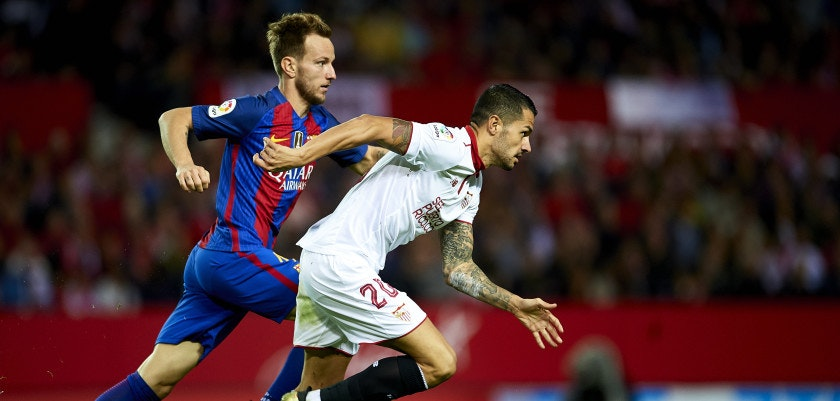 "SEVILLE, SPAIN - NOVEMBER 06:  Ivan Rakitic of FC Barcelona (L) competes for the ball with Victor Machin Perez ""Vitolo"" of Sevilla FC (R) during the match between Sevilla FC vs FC Barcelona as part of La Liga at Ramon Sanchez Pizjuan Stadium on November 6, 2016 in Seville, Spain.  (Photo by Aitor Alcalde/Getty Images)"