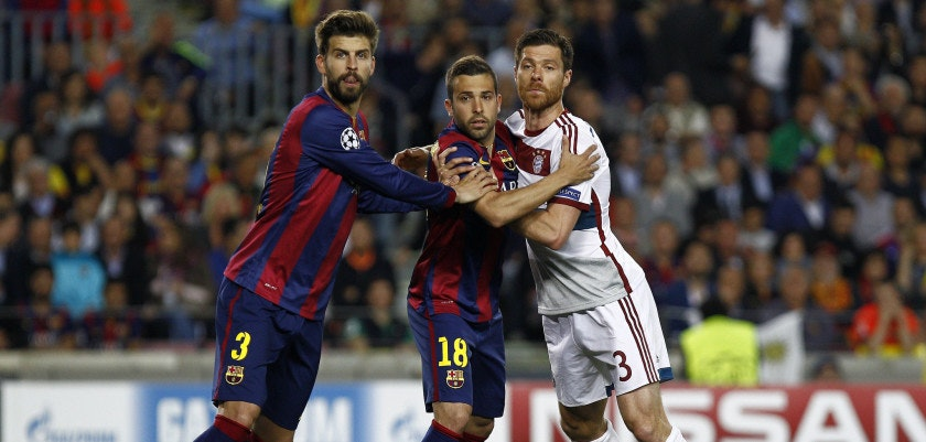 Bayern Munich's Spanish midfielder Xabi Alonso (R) pushes Barcelona's defender Jordi Alba (C) next to Barcelona's defender Gerard Pique (L) during the UEFA Champions League football match FC Barcelona vs FC Bayern Muenchen at the Camp Nou stadium in Barcelona on May 6, 2015.     AFP PHOTO/ QUIQUE GARCIA        (Photo credit should read QUIQUE GARCIA/AFP/Getty Images)