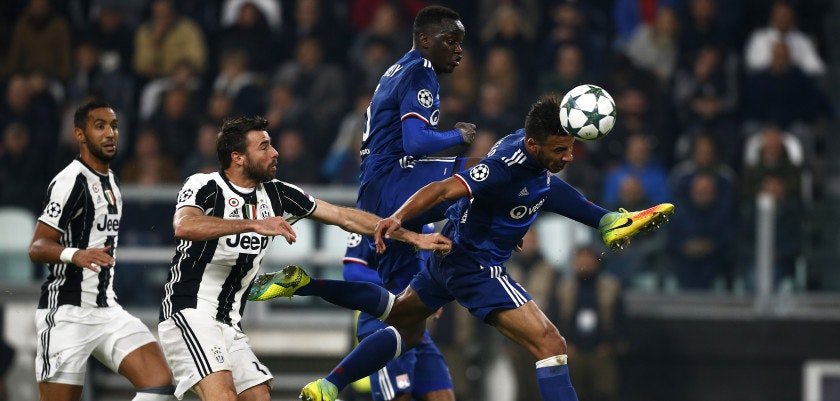 Lyon's French midfielder Corentin Tolisso (R) scores during the UEFA Champions League football match Juventus vs Olympique Lyonnais on November 2, 2016 at the Juventus stadium in Turin.  / AFP / MARCO BERTORELLO        (Photo credit should read MARCO BERTORELLO/AFP/Getty Images)