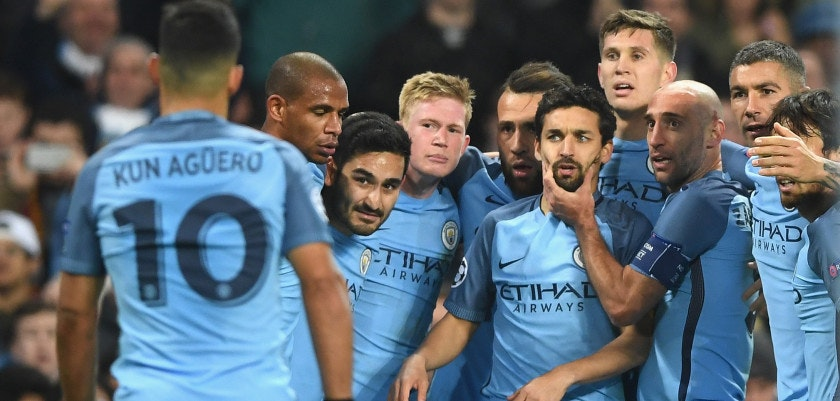 MANCHESTER, ENGLAND - NOVEMBER 01:  Ilkay Gundogan of Manchester City (CL) celebrates scoring his sides third goal with his Manchester City team mates while Sergio Aguero of Manchester City (L) comes to join them during the UEFA Champions League Group C match between Manchester City FC and FC Barcelona at Etihad Stadium on November 1, 2016 in Manchester, England.  (Photo by Shaun Botterill/Getty Images)