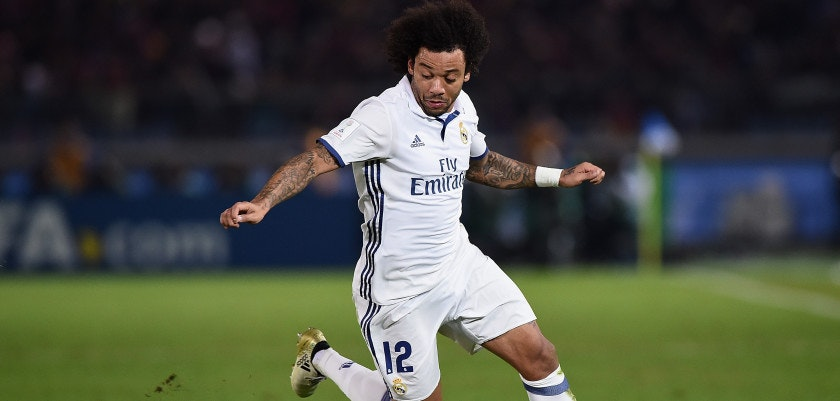 YOKOHAMA, JAPAN - DECEMBER 18:  Marcelo of Real Madrid competes for the ball during the FIFA Club World Cup final match between Real Madrid and Kashima Antlers at International Stadium Yokohama on December 18, 2016 in Yokohama, Japan.  (Photo by Matt Roberts/Getty Images)