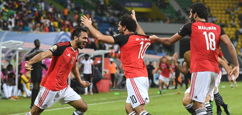 Egypt's midfielder Mahmoud Abdel-Moneim (L) celebrates with forwards Mohamed Salah and Marwan Mohsen after Egypt scored a goal during the 2017 Africa Cup of Nations group D football match between Egypt and Uganda in Port-Gentil on January 21, 2017. / AFP / Justin TALLIS        (Photo credit should read JUSTIN TALLIS/AFP/Getty Images)