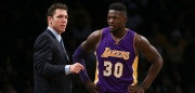 NEW YORK, NY - DECEMBER 14:  Head coach Luke Walton and Julius Randle #30 of the Los Angeles Lakers look on against the Brooklyn Nets in the second half at Barclays Center on December 14, 2016 in the Brooklyn borough of New York City. NOTE TO USER: User expressly acknowledges and agrees that, by downloading and/or using this Photograph, user is consenting to the terms and conditions of the Getty Images License Agreement.  (Photo by Michael Reaves/Getty Images)
