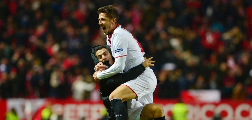 Sevilla's Montenegrin forward Stevan Jovetic (R) celebrates with Sevilla's French forward Wissam Ben Yedder after scoring the 2-1 victory goal during the Spanish league football match Sevilla FC vs Real Madrid CF at the Ramon Sanchez Pizjuan stadium in Sevilla on January 15, 2017. Sevilla won 2-1. / AFP / CRISTINA QUICLER        (Photo credit should read CRISTINA QUICLER/AFP/Getty Images)