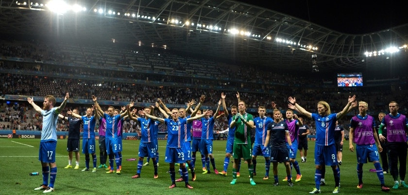 Iceland's players celebrate their team's win with supporters after the Euro 2016 round of 16 football match between England and Iceland at the Allianz Riviera stadium in Nice on June 27, 2016.   Iceland won the match 1-2. / AFP / BERTRAND LANGLOIS        (Photo credit should read BERTRAND LANGLOIS/AFP/Getty Images)