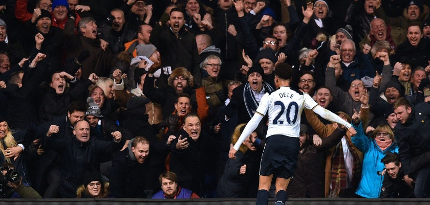 Tottenham Hotspur's English midfielder Dele Alli celebrates with fans after scoring the opening goal of the English Premier League football match between Tottenham Hotspur and Chelsea at White Hart Lane in London, on January 4, 2017. / AFP / IKIMAGES / IKIMAGES / RESTRICTED TO EDITORIAL USE. No use with unauthorized audio, video, data, fixture lists, club/league logos or 'live' services. Online in-match use limited to 45 images, no video emulation. No use in betting, games or single club/league/player publications.        (Photo credit should read IKIMAGES/AFP/Getty Images)