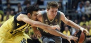 Real Madrid's Slovenian guard Luka Doncic (R) vies with Fenerbahce Ulker's Greek guard Kostas Sloukas (L)  during the Euroleague basketball playoff second match between Fenerbahce Ulker and Real Madrid on April 14, 2016 at the Fenerbahce Ulker arena in Istanbul.  / AFP / OZAN KOSE        (Photo credit should read OZAN KOSE/AFP/Getty Images)