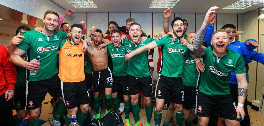 BURNLEY, ENGLAND - FEBRUARY 18: The Lincoln City team celebrate their win in the changing room after The Emirates FA Cup Fifth Round match between Burnley and Lincoln City at Turf Moor on February 18, 2017 in Burnley, England.  (Photo by Jan Kruger/Getty Images)