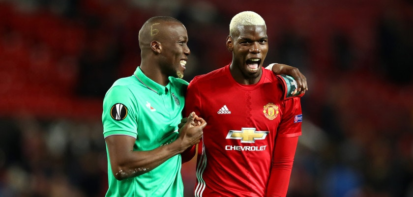 MANCHESTER, ENGLAND - FEBRUARY 16:  Paul Pogba of Manchester United (R) and Florentin Pogba of Saint Ettienne speak during the UEFA Europa League Round of 32 first leg match between Manchester United and AS Saint-Etienne at Old Trafford on February 16, 2017 in Manchester, United Kingdom.  (Photo by Clive Brunskill/Getty Images)