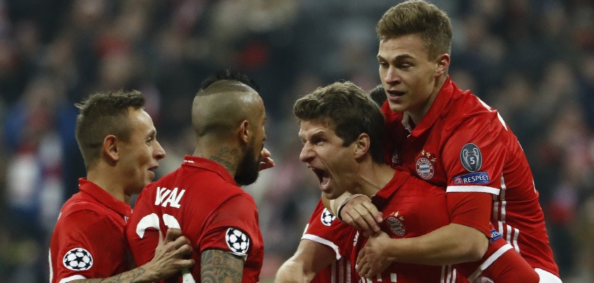 TOPSHOT - Bayern Munich's forward Thomas Mueller (C) celebrate scoring the 5-1 goal with his teammates during the UEFA Champions League round of sixteen football match between FC Bayern Munich and Arsenal in Munich, southern Germany, on February 15, 2017.  / AFP / Odd ANDERSEN        (Photo credit should read ODD ANDERSEN/AFP/Getty Images)