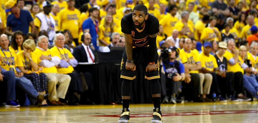 OAKLAND, CA - JUNE 19:  Kyrie Irving #2 of the Cleveland Cavaliers reacts to a play against the Golden State Warriors in Game 7 of the 2016 NBA Finals at ORACLE Arena on June 19, 2016 in Oakland, California. NOTE TO USER: User expressly acknowledges and agrees that, by downloading and or using this photograph, User is consenting to the terms and conditions of the Getty Images License Agreement.  (Photo by Ezra Shaw/Getty Images)