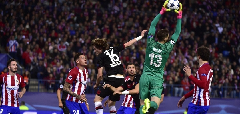 TOPSHOT - Atletico Madrid's Slovenian goalkeeper Jan Oblak stops a ball during the UEFA Champions League round of 16 second leg football match Club Atletico de Madrid vs Bayer Leverkusen at the Vicente Calderon stadium in Madrid on March 15, 2017. / AFP PHOTO / GERARD JULIEN        (Photo credit should read GERARD JULIEN/AFP/Getty Images)
