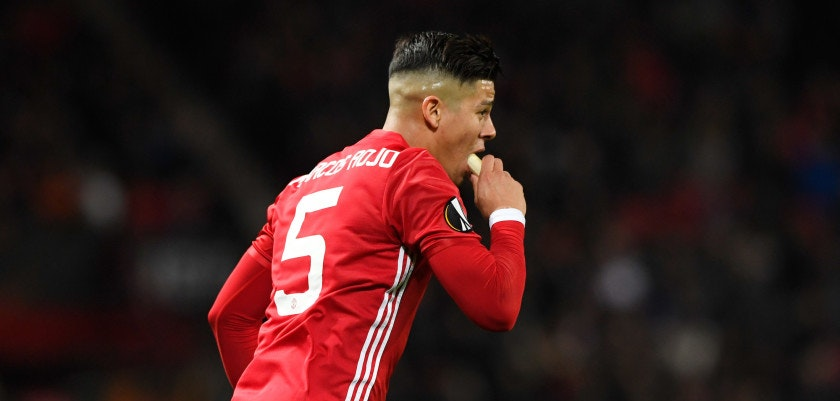 MANCHESTER, ENGLAND - MARCH 16:  Marcos Rojo of Manchester United eats a banana during the UEFA Europa League Round of 16, second leg match between Manchester United and FK Rostov at Old Trafford on March 16, 2017 in Manchester, United Kingdom.  (Photo by Stu Forster/Getty Images)