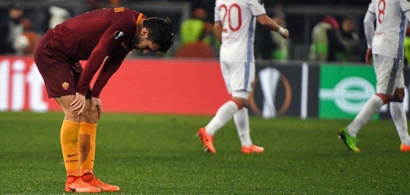Roma's Dutch midfielder Kevin Strootman (L) reacts at the end of the qualifying UEFA Europa League match AS Roma versus Lyon at Rome's Olympic stadium, on March 16, 2017. / AFP PHOTO / ANDREAS SOLARO        (Photo credit should read ANDREAS SOLARO/AFP/Getty Images)