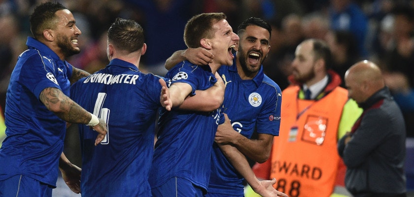TOPSHOT - Leicester City's English midfielder Marc Albrighton (C) celebrates scoring their second goal during the UEFA Champions League round of 16 second leg football match between Leicester City and Sevilla at the King Power Stadium on March 14, 2017. / AFP PHOTO / Oli SCARFF        (Photo credit should read OLI SCARFF/AFP/Getty Images)