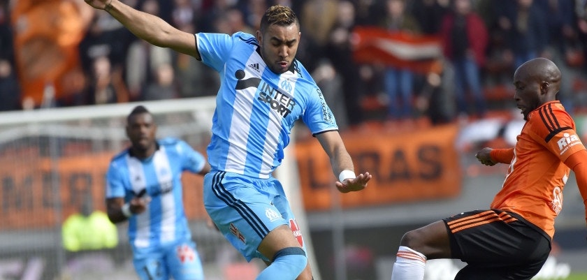 Marseille's French forward Dimitri Payet (L) vies with Lorient's French defender Erwin Koffi during the French L1 football match between Lorient (FCL) and Marseille (OM) at the Moustoir stadium in Lorient, western France, on March 5, 2017.       / AFP PHOTO / LOIC VENANCE        (Photo credit should read LOIC VENANCE/AFP/Getty Images)