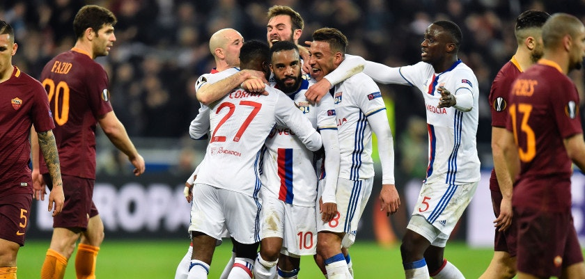 Lyon's French forward Alexandre Lacazette (C) celebrates with teammates after scoring a goal during the UEFA Europa League round of 16 football match between Lyon and AS Roma at the Parc Olympique Lyonnais stadium in Decines-Charpieu near Lyon, central-eastern France, on March 9, 2017. / AFP PHOTO / ROMAIN LAFABREGUE        (Photo credit should read ROMAIN LAFABREGUE/AFP/Getty Images)