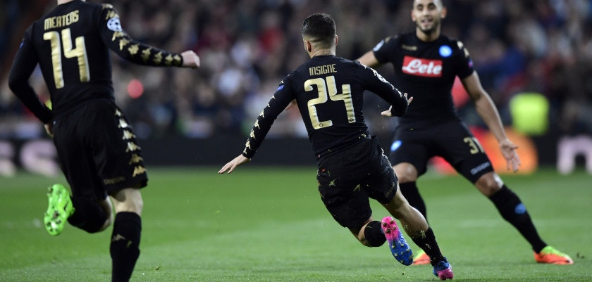 Napoli's midfielder Lorenzo Insigne (C) celebrates a goal during the UEFA Champions League round of 16 first leg football match Real Madrid CF vs SSC Napoli at the Santiago Bernabeu stadium in Madrid on February 15, 2017. / AFP / JAVIER SORIANO        (Photo credit should read JAVIER SORIANO/AFP/Getty Images)