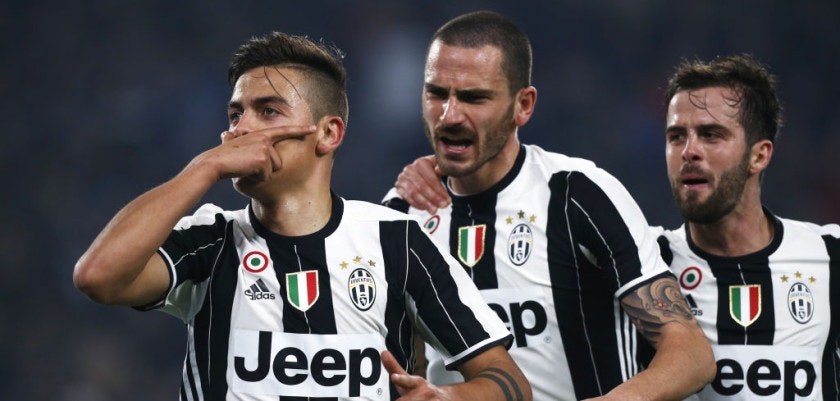 Juventus' forward Paulo Dybala from Argentina (L) celebrates after scoring with his teammates Juventus' defender Leonardo Bonucci (C) and Juventus' midfielder Morale Pijanic of Bosnia-Erzegovina during the Italian Tim Cup football match between Juventus and Napoli on February 28, 2017, at the Juventus Stadium in Turin. / AFP / Marco BERTORELLO        (Photo credit should read MARCO BERTORELLO/AFP/Getty Images)